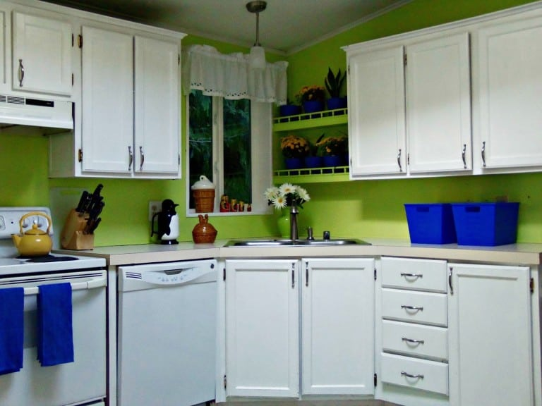 white kitchen cabinets with bright green walls