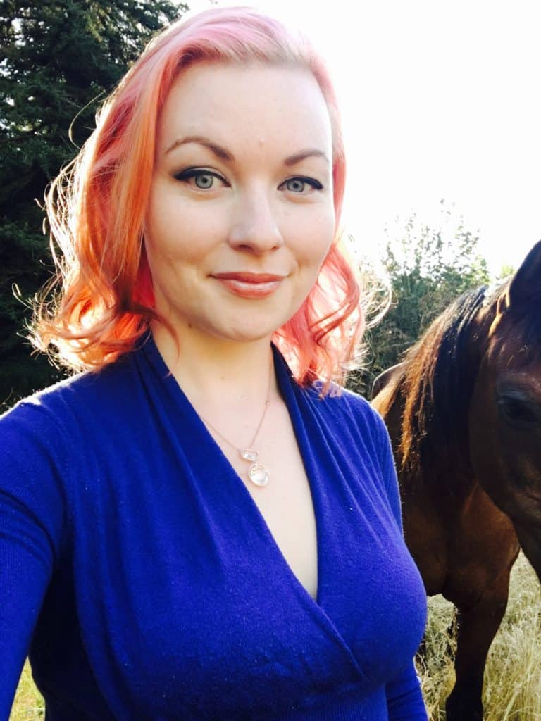 pink hair woman with horse blue shirt