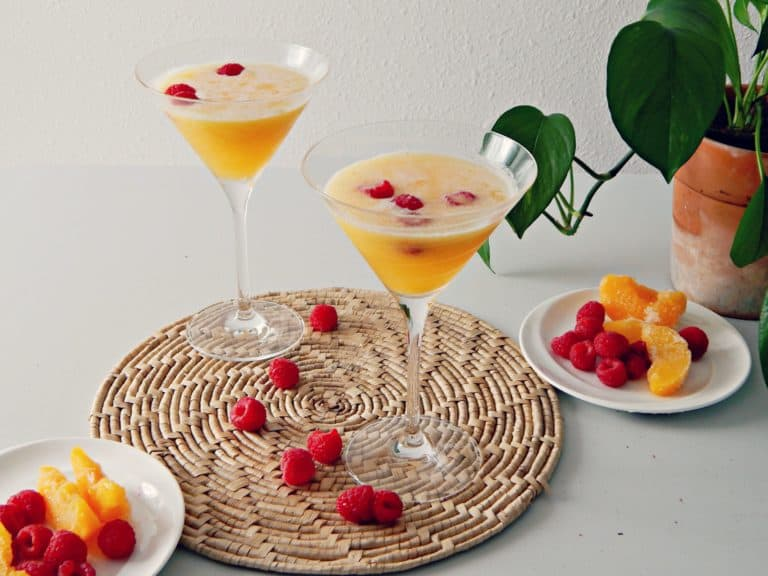 two peach bellini drinks