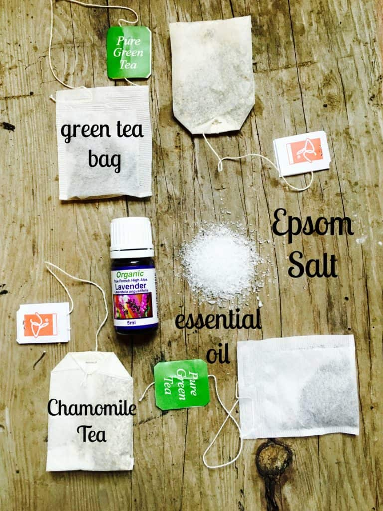 supplies for bath salts tea bags salt and lavender oil on wood table