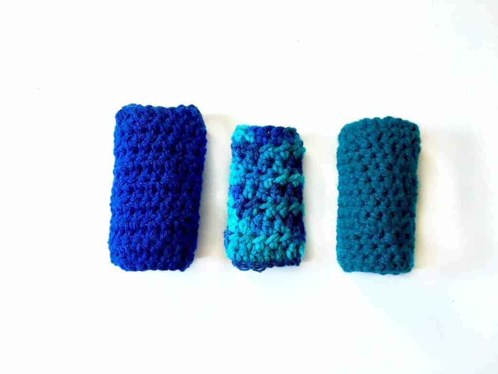 three finished ice pop cozies laid out on a white table