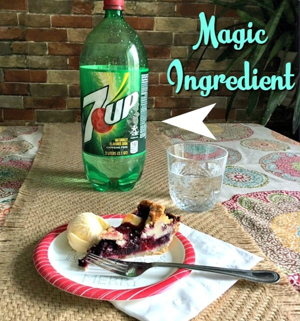 triple berry pie with bottle of 7 up for the pie crust