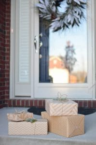 wrapped gifts sitting on front porch