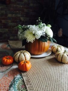 centerpiece for thanksgiving table made out of pumpkin
