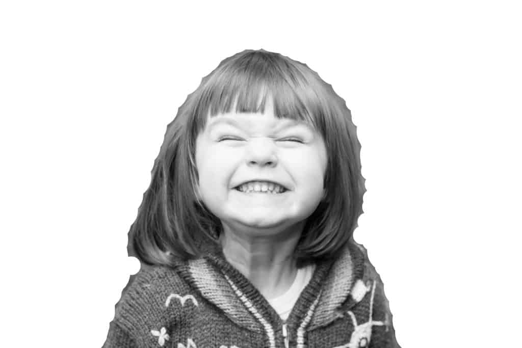 black and white photo of girl smiling with white background