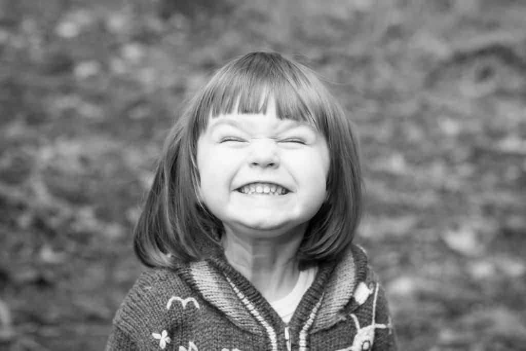 Little girl smiling excitedly for the camera