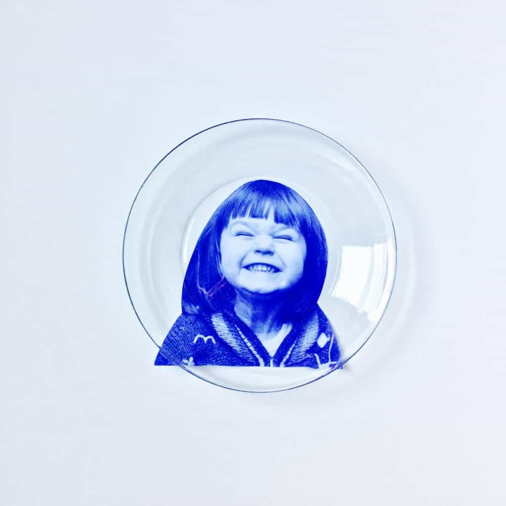 image of girl cut out and placed under glass plate