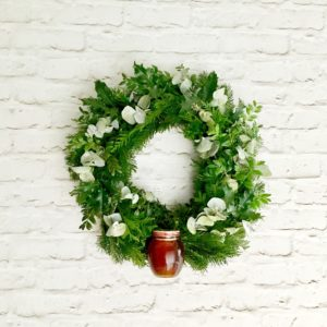 finished honey wreath hanging on wall