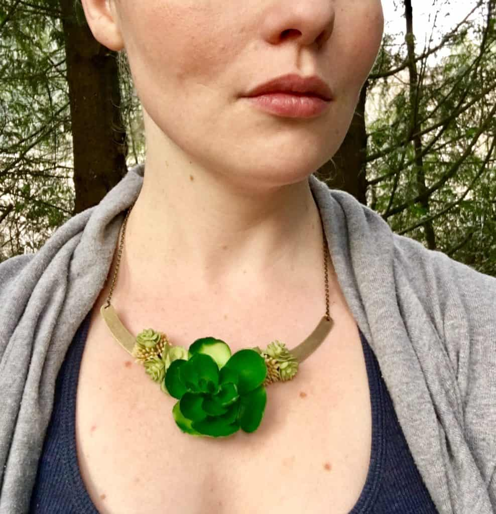 succulent necklace on woman's neck