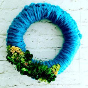 yarn wreath made with blue yarn