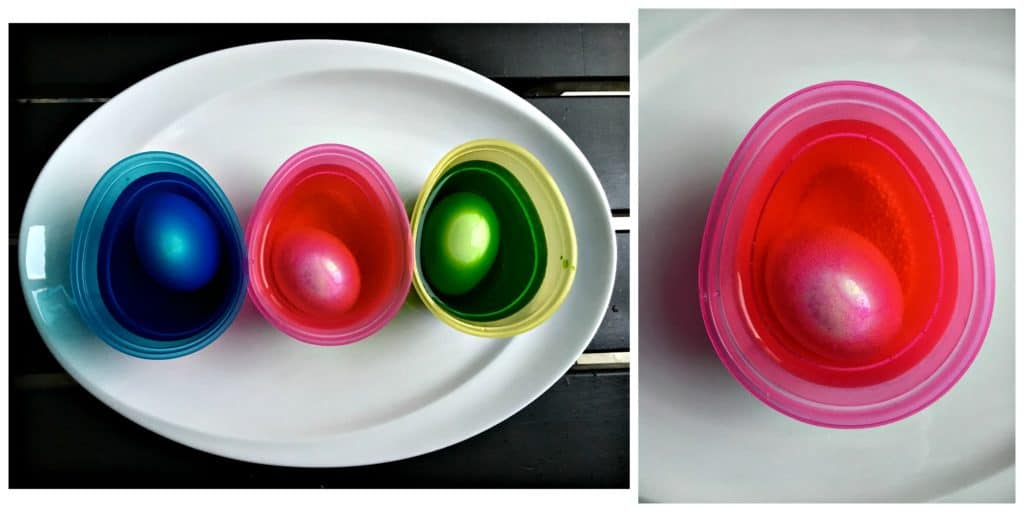 Eggs sitting is cups of dye.