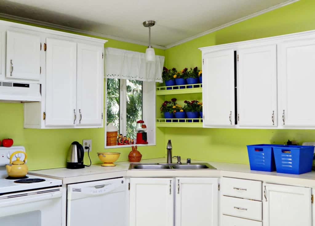 lime green kitchen with white cabinets