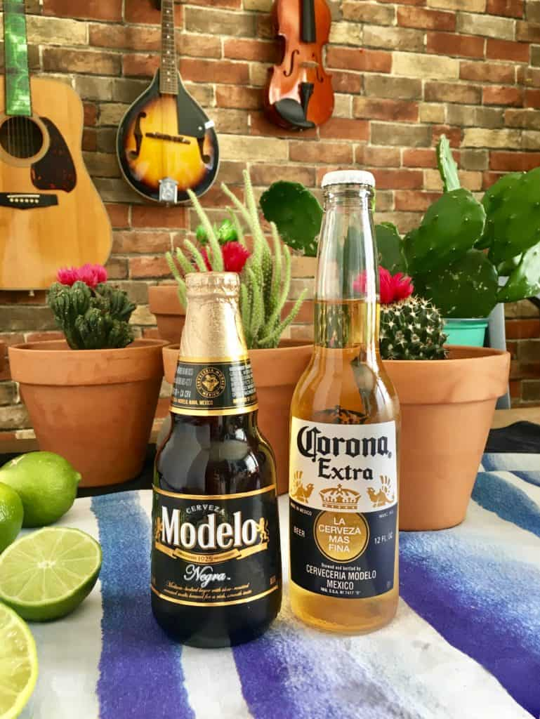 corona and modelo bottles on mexican tablescape with cacti