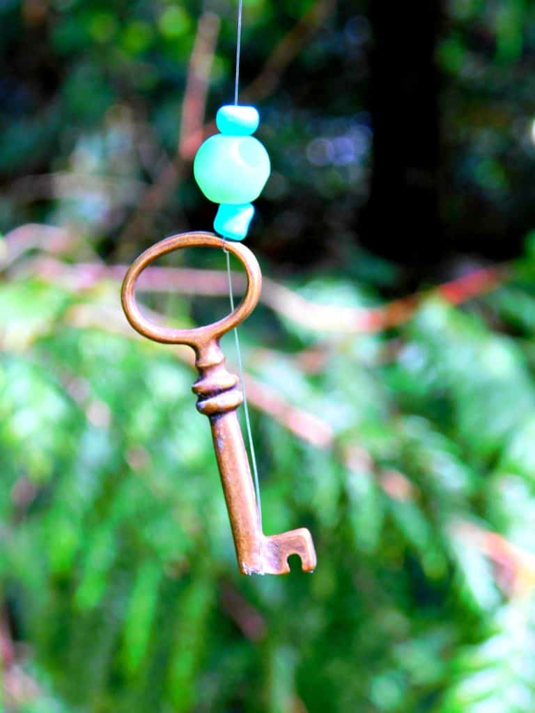 key hanging from wind chime