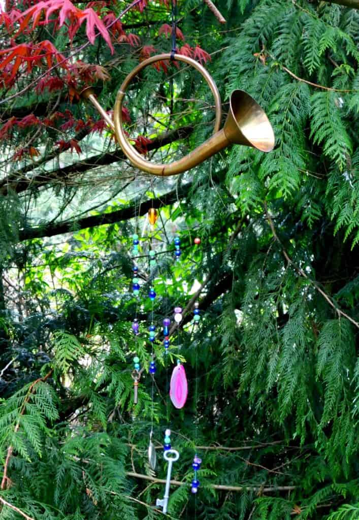 how to make a wind chime. Horn with beads hanging from a tree