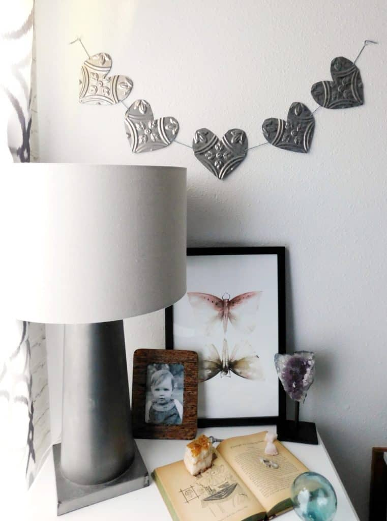 tin wall heart hanging on white wall