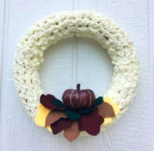 autumn wreath hanging on front door
