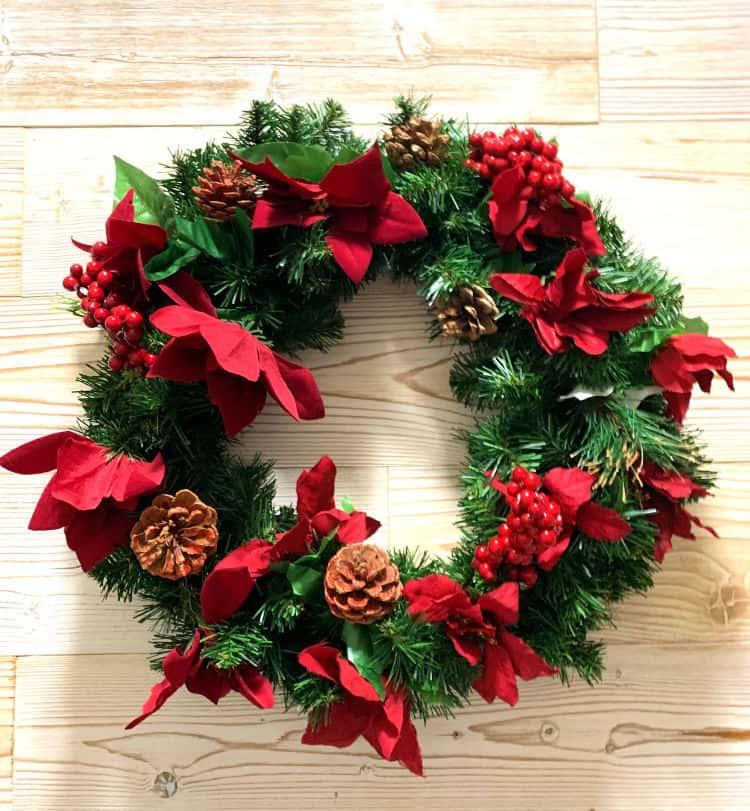 Christmas wreath on wood plank wall