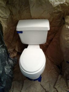 white toilet getting prepped to be painted