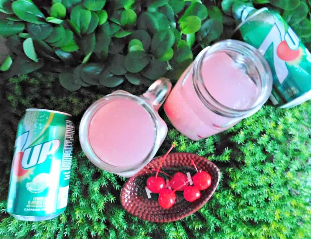 football party punch with 7UP on grass background with cherries