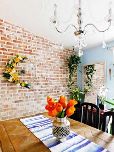 brick accent wall in dining room