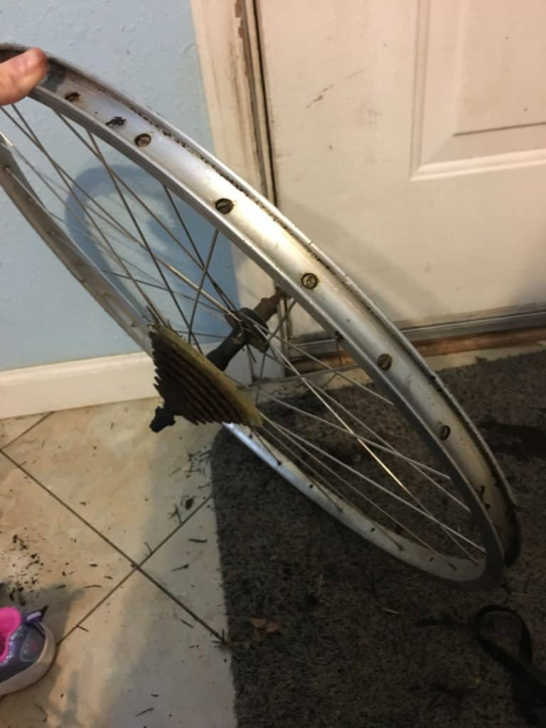 metal bike rim with tire removed