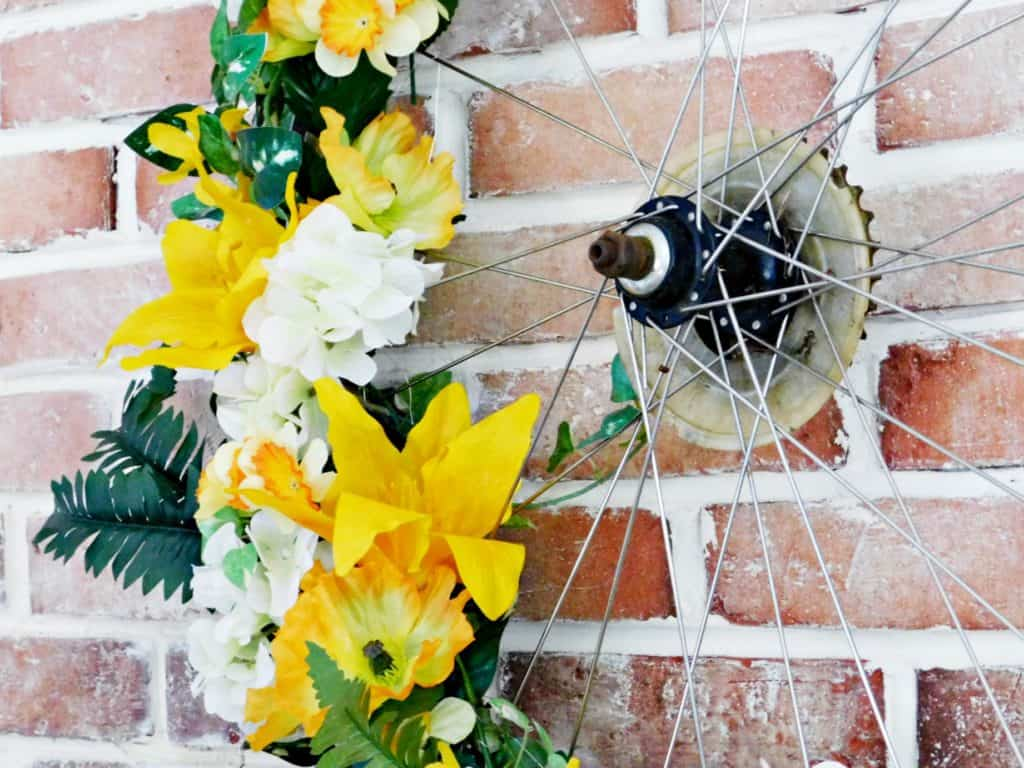 Bicycle Wheel Wreath yellow flowers close up of spokes