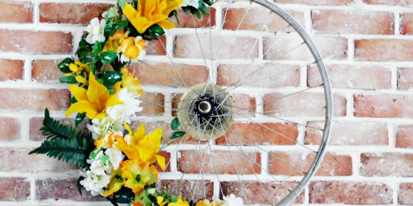 close up of finished bicycle wreath with yellow flowers on it
