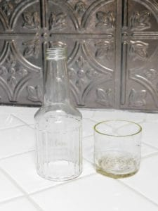 glass bottle cut in half sitting on a white counter