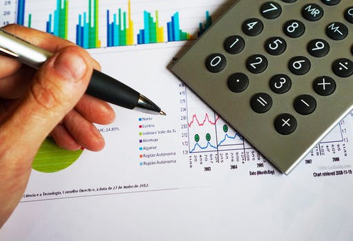 save money with budgeting calculator spreadsheet hand holding pen