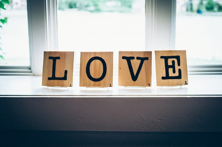 large wooden scrabble tiles spelling love
