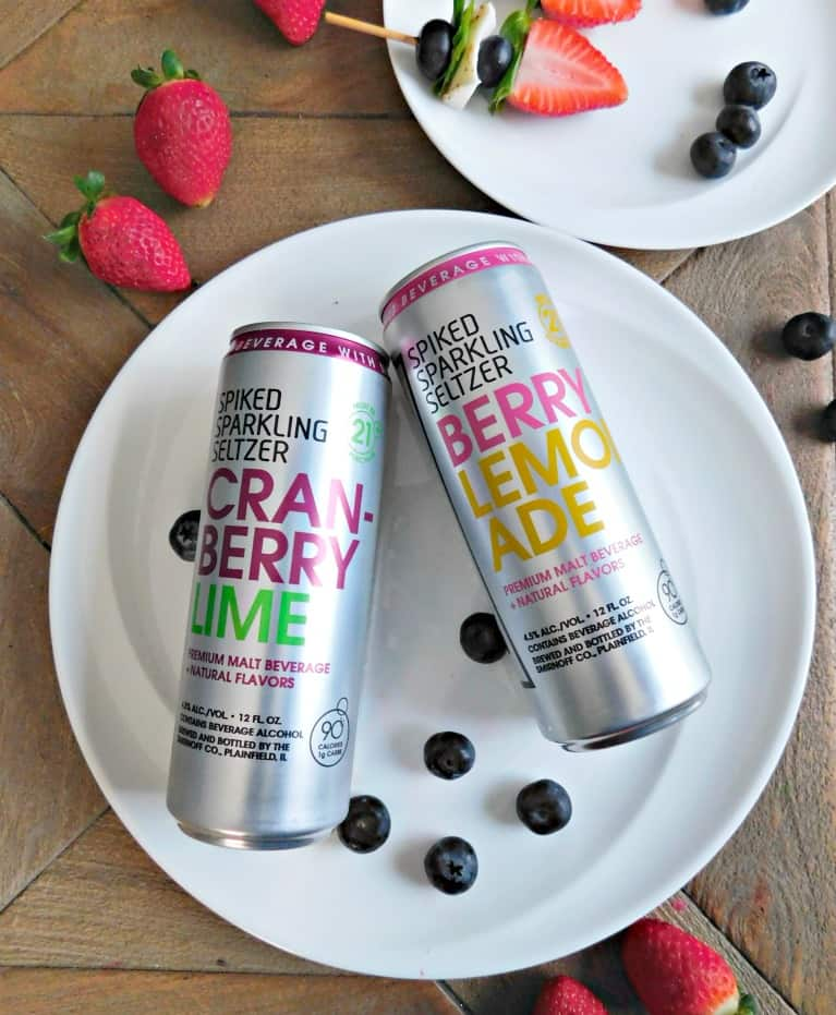 two cans of spiked sparkling seltzer on a white plate.