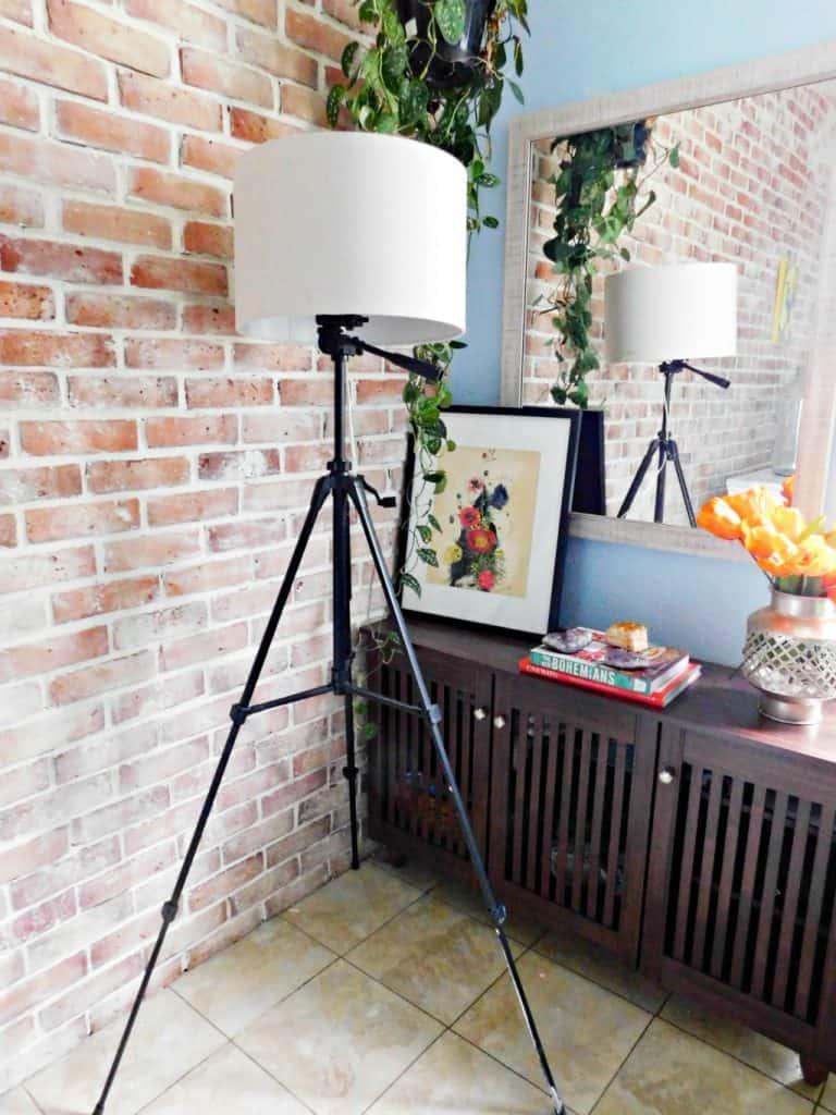tripod floor lamp in dining room