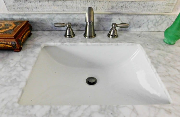 sink with marble counter and silver faucet