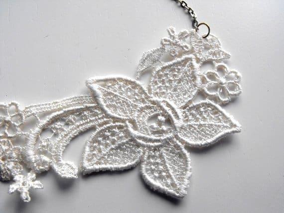 elegant ivory lace necklace on white background
