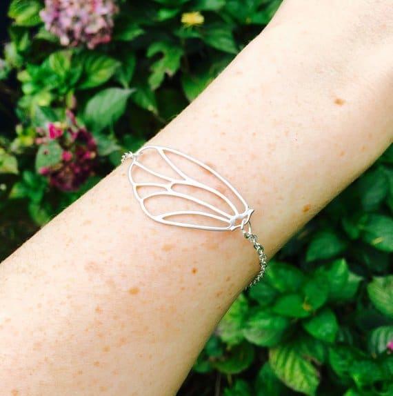 Silver butter fly bracelet on arm