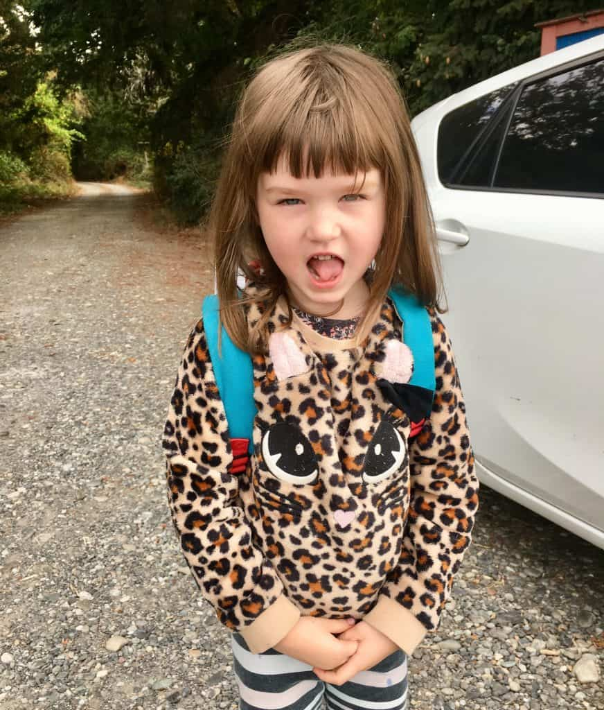 young girl with tongue sticking out