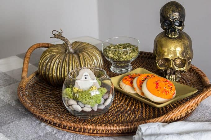 halloween terrarium on tray with cookies and pumpkins