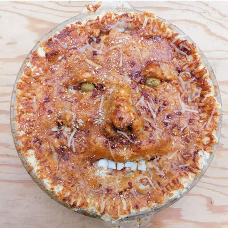 pie with human face baked into crust