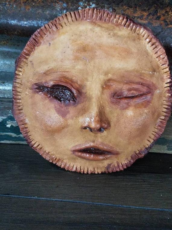 pie with human face