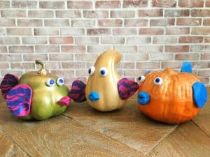 three pumpkin fish sitting on tabletop
