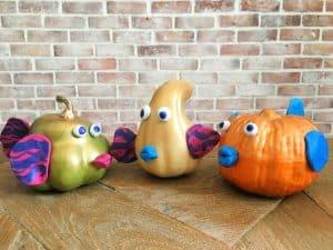 three pumpkin fish sitting on tabletop