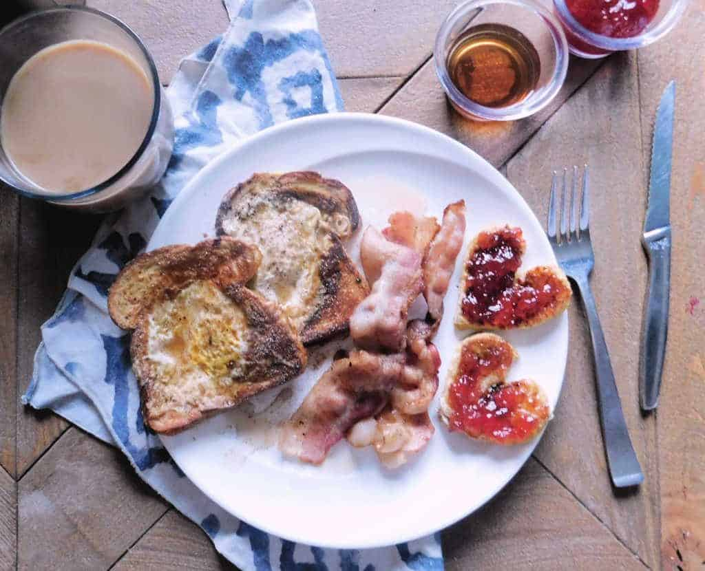 bacon, french toast and eggs on a plate