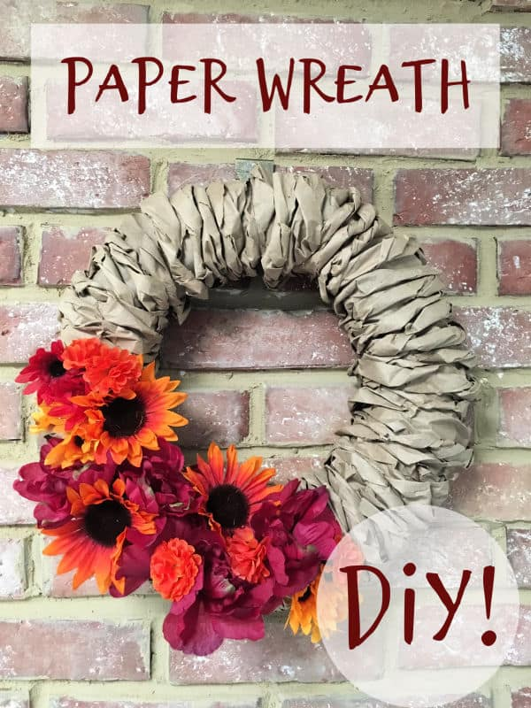 paper wreath hung on a brick wall