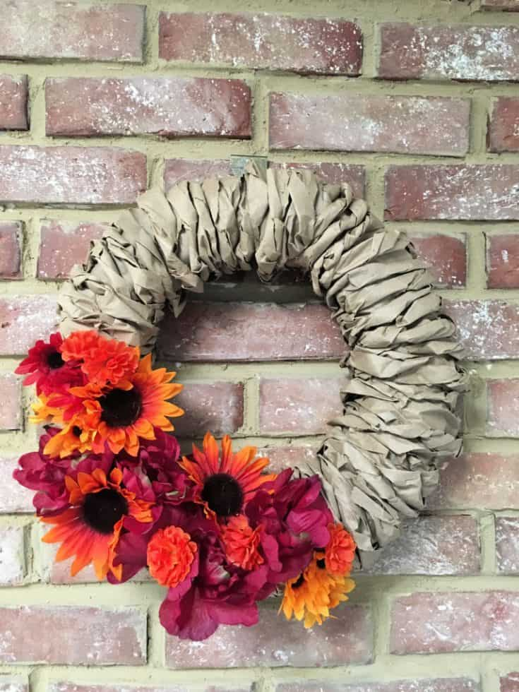 paper bag wreath completed with added flowers