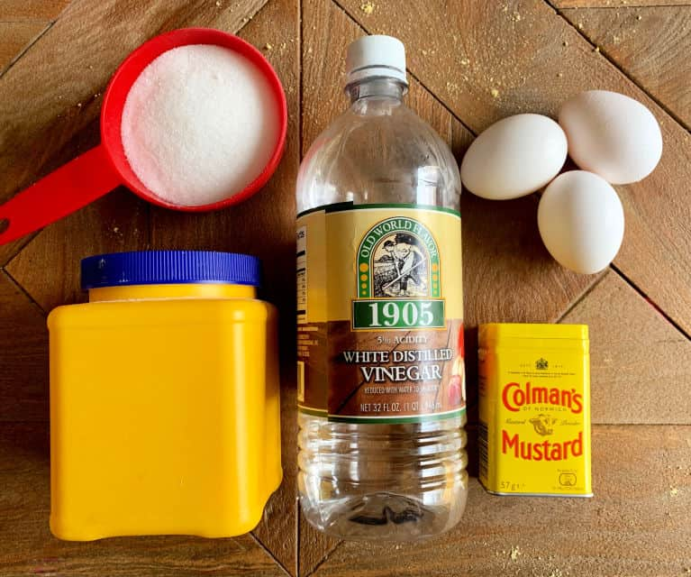 ingredients for honey mustard ham sauce on wood table.