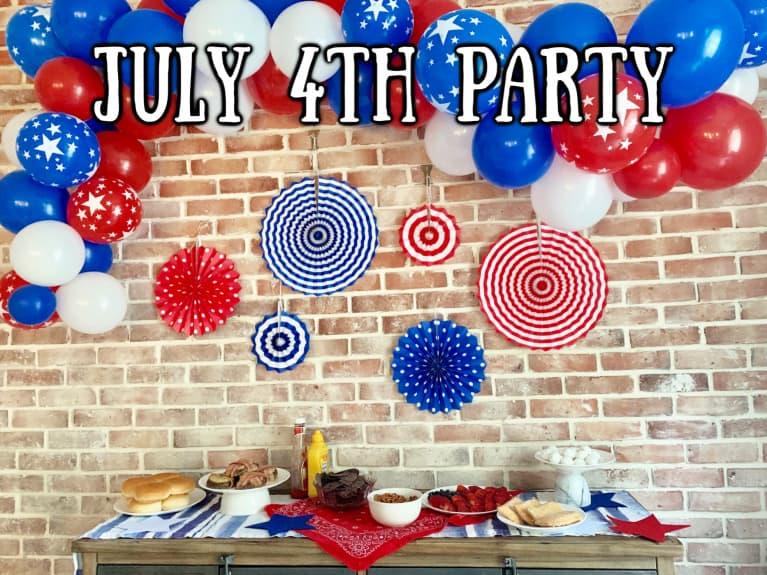 Party table set up for USA party with food and decorations