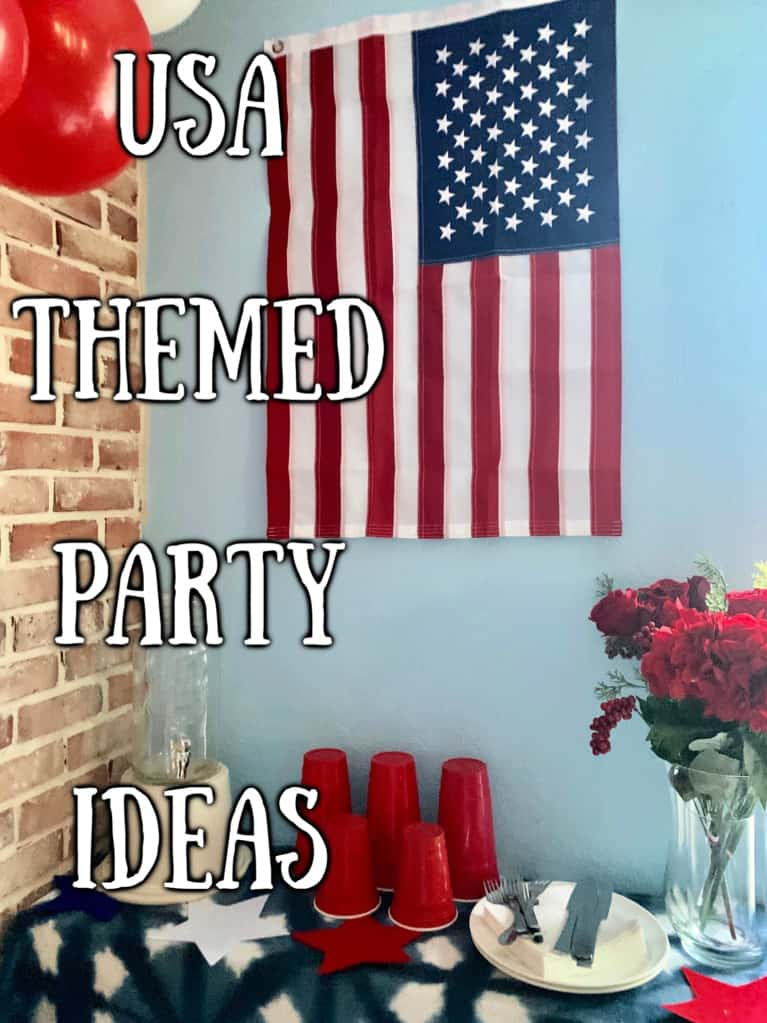 american flag hung over a table with cups and plates
