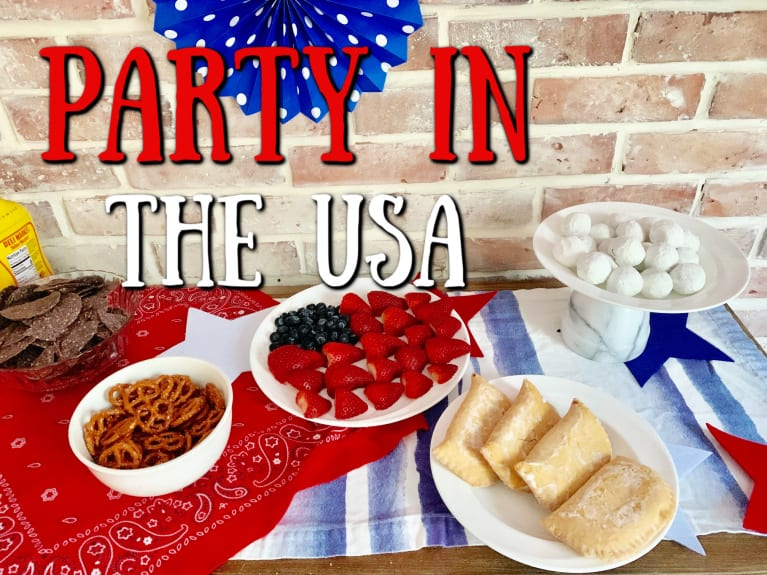 "close up of american buffet table with ""Party in the USA"" graphic overlay"
