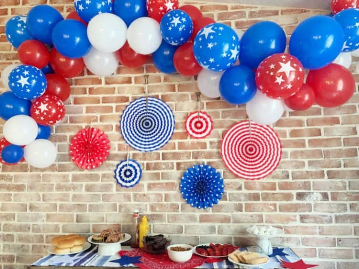 red white and blue balloon arch